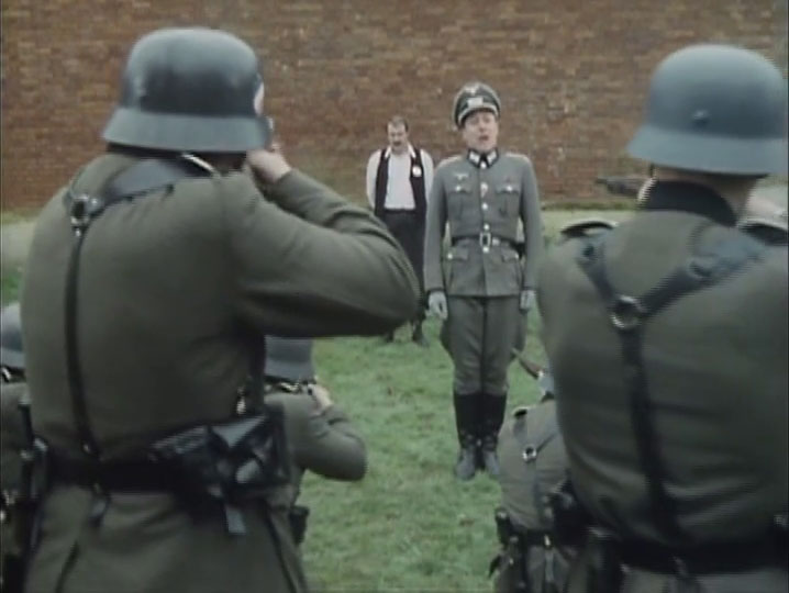 René in front of a firing squad