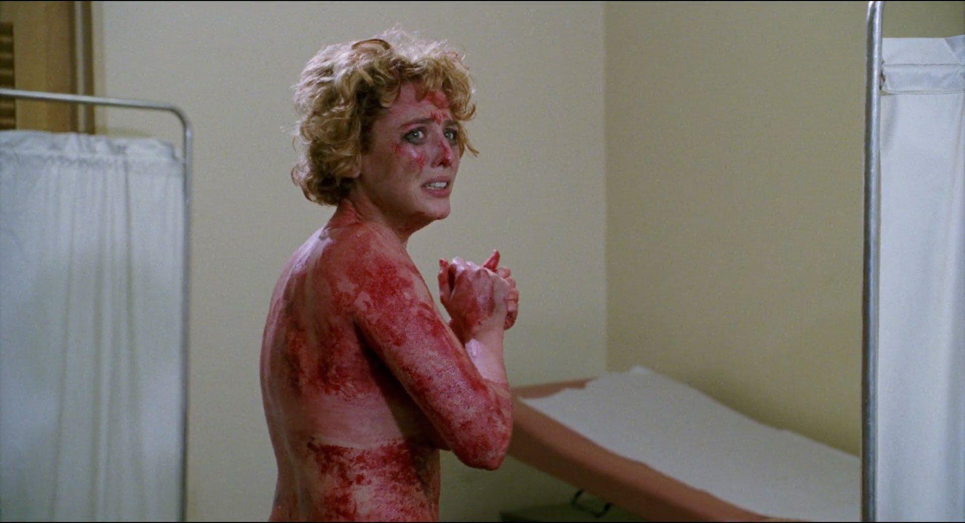 Virginia Madsen naked and covered in blood in Candyman